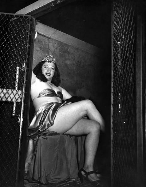 Transvestite in a police van, 1941.